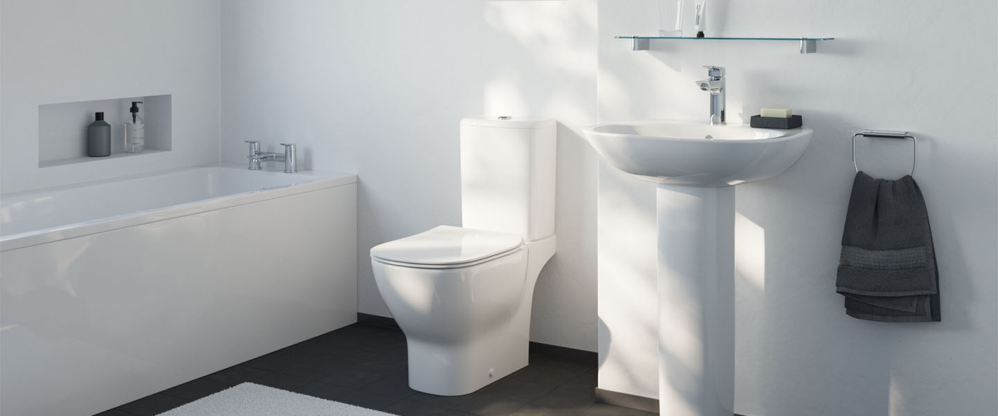 Tesi room setting image showing toilet, basin with full pedestal and straight bath with panels